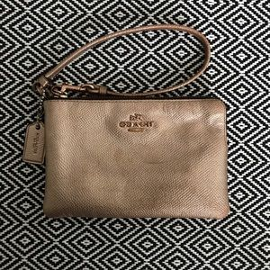 Coach metallic rose gold corner zip wristlet